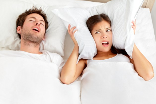 Image of woman disturbed by partners snoring